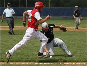 Bedford's Troy Przybylek runs past Southgate Anderson pitcher Justin Smith as he fields a grounder, during regional final game at Saline High School.