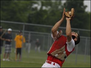 Bedford's Jared Kujawa catches a pop-up bottom of the seventh inning during a regional semifinal against Allen Park.