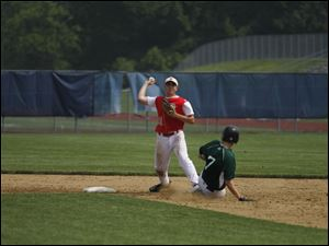 Bedford's Aaron Mills forces out Allen Park's Troy Magier on a double play.