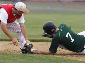 Bedford's Aaron Mills doesn't get Allen Park's Troy Magier in time to stop him from getting in safely on a steal.