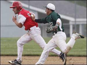 Bedford's Zach Mayo was tagged out by Allen Park's second baseman.