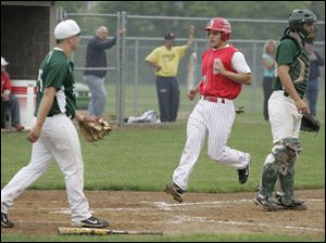 Bedford's Jackson Lamb crosses the plate during a regional semifinal game.