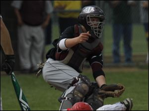 Southgate Anderson catcher Tyler Shumake tags out Zach Mayo at the plate during regional final.