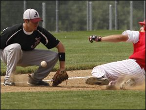 Southgate Anderson's Steve Grzywa misses the ball, allowing Bedford's Jared Kujawa to make it safely to third base.