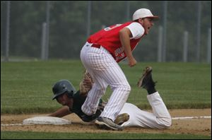 Allen Park's Mark Turner is tagged out by Bedford third baseman Troy Przybylek in the first game of the Saline regional.