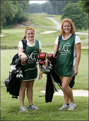 Katie, left, and Emilee Knakiewicz caddie at Sylvania Country Club. Their scholarships help them go to Michigan.