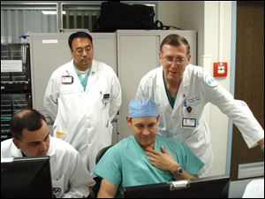 Dr. Ralph Whalen, far right, a vascular surgeon at Toledo Hospital's Jobst Vascular Institute, joins military trauma surgeons at Landstuhl Regional Medical Center in Germany during his two-week stint.