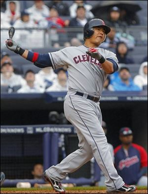 The Indians' Shin-soo Choo strikes out against the New York Yankees in the ninth inning.