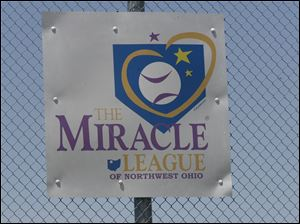 Athletes of the Miracle League of Northwest Ohio play baseball in Northwood.