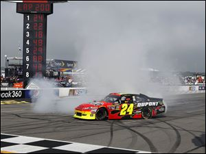 Jeff Gordon does a burnout after winning the race for his 84th career win in the NASCAR Sprint Cup Series. It is his 2nd win of the season, giving him a good chance at qualifying for the Chase.