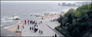 The beach at Qinhuangdao is viewed from atop the Dragon's Head, which marks the beginning of the Great Wall of China.