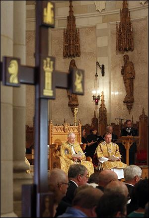 Bishop of Toledo Leonard Blair, seated at left with other members of the clergy, prepares to present honors at Rosary Cathedral on Collingwood Boulevard.
