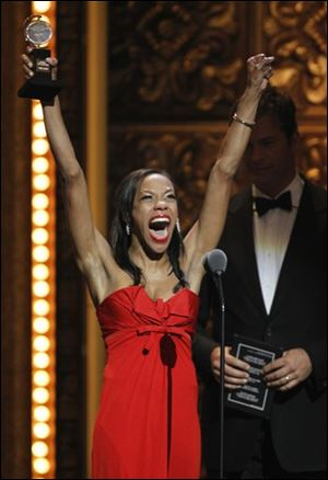 Nikki M. James hoists her Tony for Best Performance by an Actress in a Featured Role in a Musical; she is part of 'The Book of Mormon' cast.