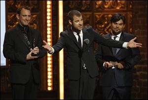 Matt Stone, flanked by co-winners Trey Parker, left, and Robert Lopez, accepts the Tony for Best Book of a Musical. They won for 'The Book of Mormon.'
