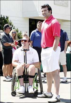 Brothers Brock Mealer, left, and Blake Mealer get ready for the David Mealer Memorial Golf Classic at Brandywine.