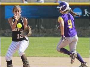 Clinton's Haley Mercy (12) makes a play as Blissfield's Courtney Brothers (9) heads to second base during the first inning.