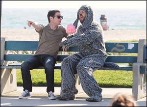 Elijah Wood plays Ryan, a neurotic single guy who attempts suicide in the first episode, in the new FX comedy 'Wilfred.' Australian Jason Gann plays wise-cracking Wilfred.