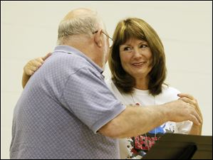 Smith Road Principal Carol Perz embraces Dave Sirava after he read a poem during the goodbye ceremony.