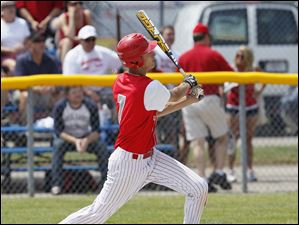 Bedford's Jackson Lamb hits a triple in his first at bat against Sterling Heights Stevenson in the Michigan High School Division 1 state baseball semifinals at Bailey Park, in Battle Creek.