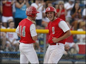 Bedford's Zach Mayo, left, and Troy Przybylek celebrate in the seventh inning after the Mules went up 10-5 over Sterling Heights Stevenson.