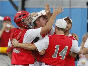 Bedford players celebrate after beating Sterling Heights Stevenson 10-5 in the Michigan High School Division 1 state baseball semifinals.