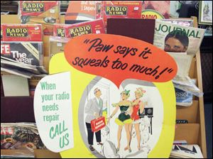 Vintage advertising signs are for sale at Summertyme in the Maumee Antique Mall.