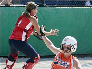 Summerfield's Kelsea Reed (50) scores against Unionville-Sebewaing catcher Ashlyn VanHoost (2) during the third inning.