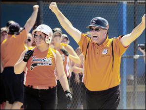 Summerfield softball coach Robert Taylor celebrates a 6-5 victory over Unionville-Sebewaing in a Division 4 state championship game.