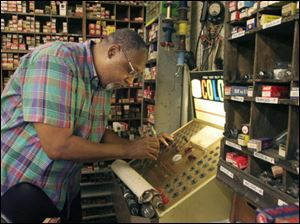 Bennie Summers, owner of Summertyme Vintage Radio Repair, works at his shop in the Maumee Antique Mall.