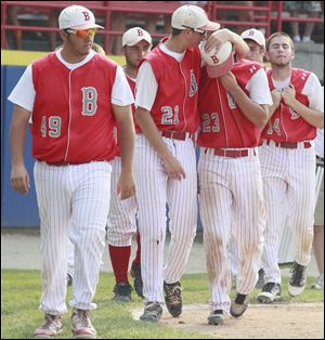 Bedford players Mike Blake (49), Kyle Kuhr (21), Troy Przybylek (23), and Zach Mayo (14) walk off the field after losing the Division 1 state baseball final to Rockford. The Mules finished with a 36-7 record.