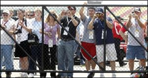 Fans get as close as possible to get a glimpse and photos of Dale Earnhardt, Jr. It's just part of the day for the son of the legendary driver.