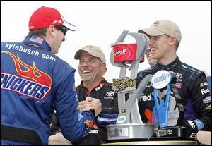 Teammate Kyle Busch congratulates Denny Hamlin for getting a victory for Joe Gibbs Racing. Busch had a solid afternoon too, finishing in third place.
