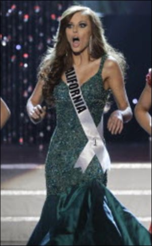 Miss California, Alyssa Campanella, 21, reacts upon being named a finalist at the Miss USA pageant. She was crowned Miss USA a few hours later.