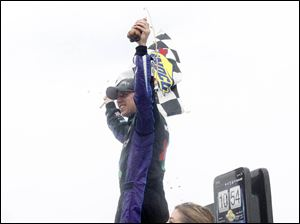 Denny Hamlin celebrates his win in the NASCAR Sprint Cup Series Race at Michigan International Speedway.