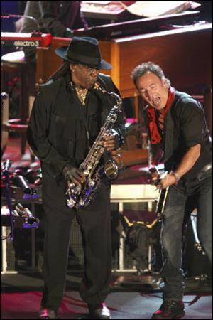 "Clarence Clemons, left, performs at the Stone Pony with Bruce Springsteen. The larger-than-life saxophone player who helped catapult Bruce Springsteen to rock fame, was known as ""The Big Man,"" a nod to his physical size as well as his stage presence and booming sax notes."