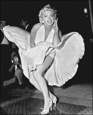 "The iconic dress Marilyn Monroe wore in ""The Seven Year Itch"" fetched $4.6 million at an auction of movie star Debbie Reynolds' memorabilia over the weekend."