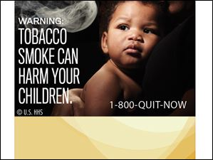 WARNING: Tobacco smoke can harm your children.
