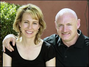 Rep. Gabrielle Giffords, left, D-Ariz., left, with her husband, NASA astronaut Mark Kelly before she was shot in the head Jan. 8 during a political event in Tucson, Ariz.