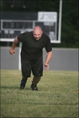 Chris Morris has been working out on the Bedford High football field while he waits for the lockout to end. He was drafted by the Raiders in 2006 after playing on the offensive line at Michigan State.