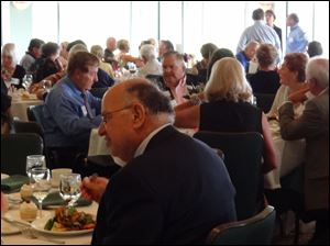 Guests enjoy a meal at the preview party before Toledo Day Nursery's annual garden tour.