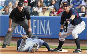 Toledo first baseman Ryan Strieby tries to tag Columbus Clippers' Ezequiel Carrera (7) on a dive back in the first inning Thursday.