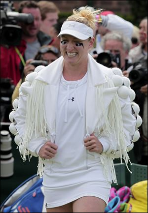 Bethanie Mattek-Sands of the US arrives on court prior to her match against Japan's Misaki Doi at the All England Lawn Tennis Championships at Wimbledon.