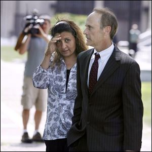 Amera Akl and her attorney, Sanford Schulman, leave U.S. District Court after sentencing in the Hezbollah funding case.