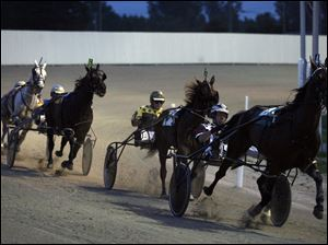 Casino developer Penn national has told the state racing commission that it will seek permission to relocate Raceway Park if racetrack slot machines become reality.