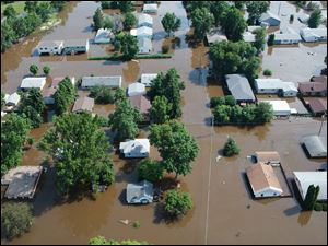 A  Minot, N.D., neighborhood is submerged Thursday by flood water from the Souris River.