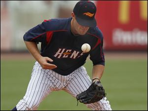 Hens shortstop Danny Worth bobbles a grounder hit by the Bats' Kristopher Negron.
