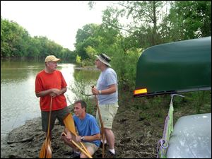 Paddlers Jaeger, Horvat, and Hebert check out the launch site at Kreager Park in Fort Wayne, Indiana, on the eve of the Fort-to-Port canoe trip.