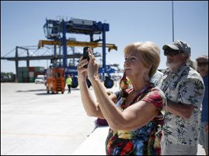 Vicky Graf, of Bowling Green, takes a photo during the crane demonstration.