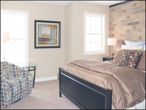 The master bedroom is a comfortable, relaxing space.
