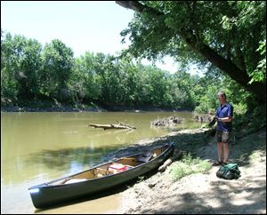 John Jaeger, left, and Lou Hebert finish the final strokes into Antwerp Park Tuesday to complete the first leg of their 130-mile 'Fort-to-Port' canoe trip.